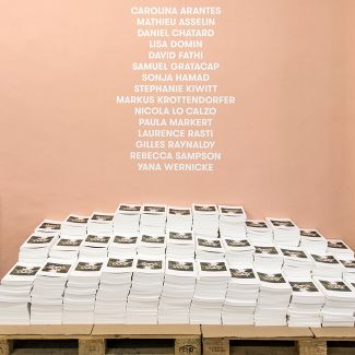 The FOTODOKS catalogue (designed by Martin Steiner) and the list of all participants (photo: Dominik Gigler)